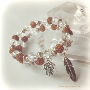 Heligt armband med rudraksha-frö och bergkristall